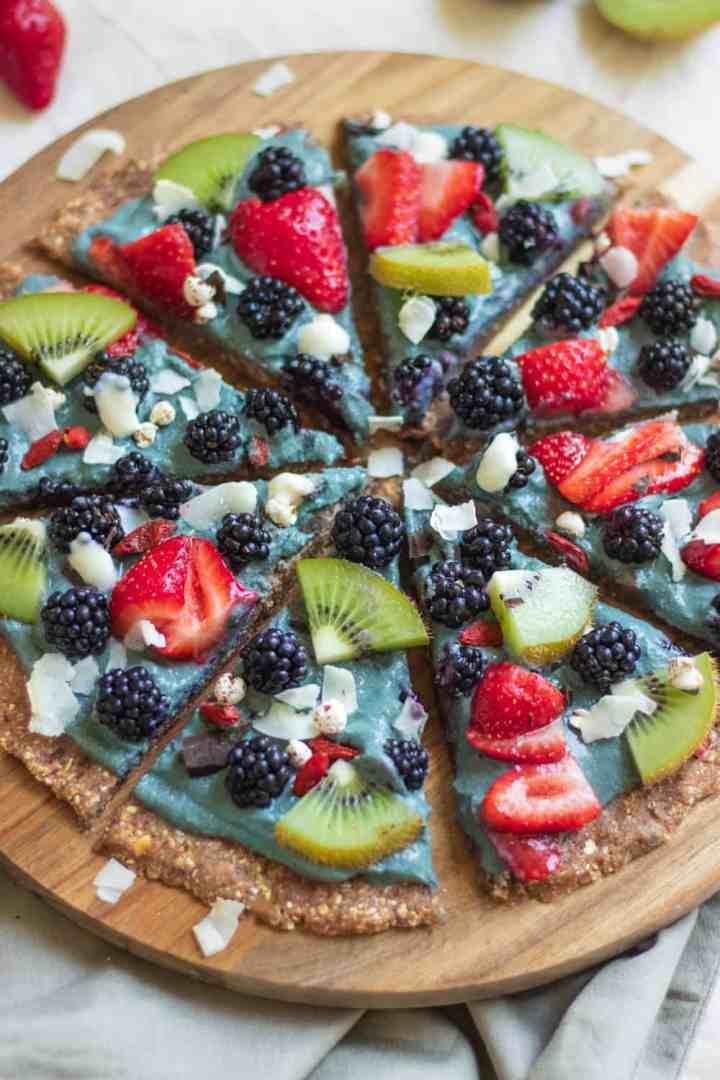 Vegan dessert pizza with fresh berries and blackberry yoghurt sauce