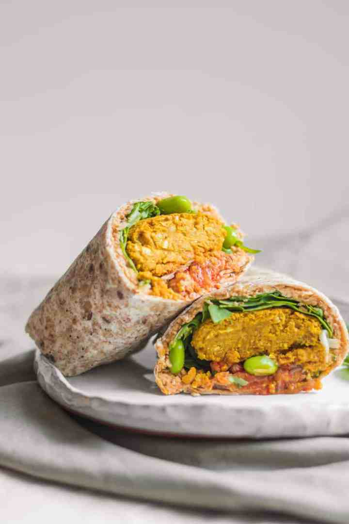 Vegan baked falafel wraps with hummus and edamame