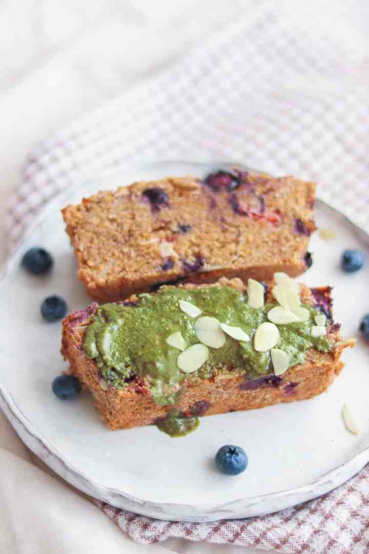 Healthy vegan polenta cake with nut butter and blueberries