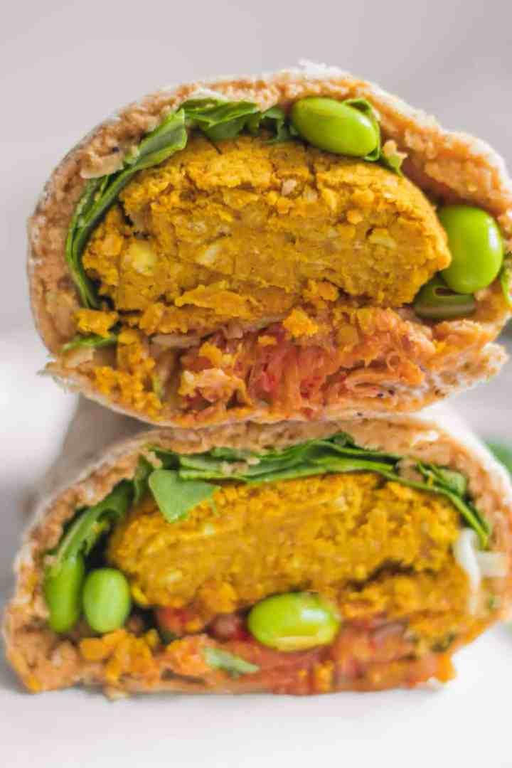 Vegan wrap with oil-free baked falafels, hummus and edamame