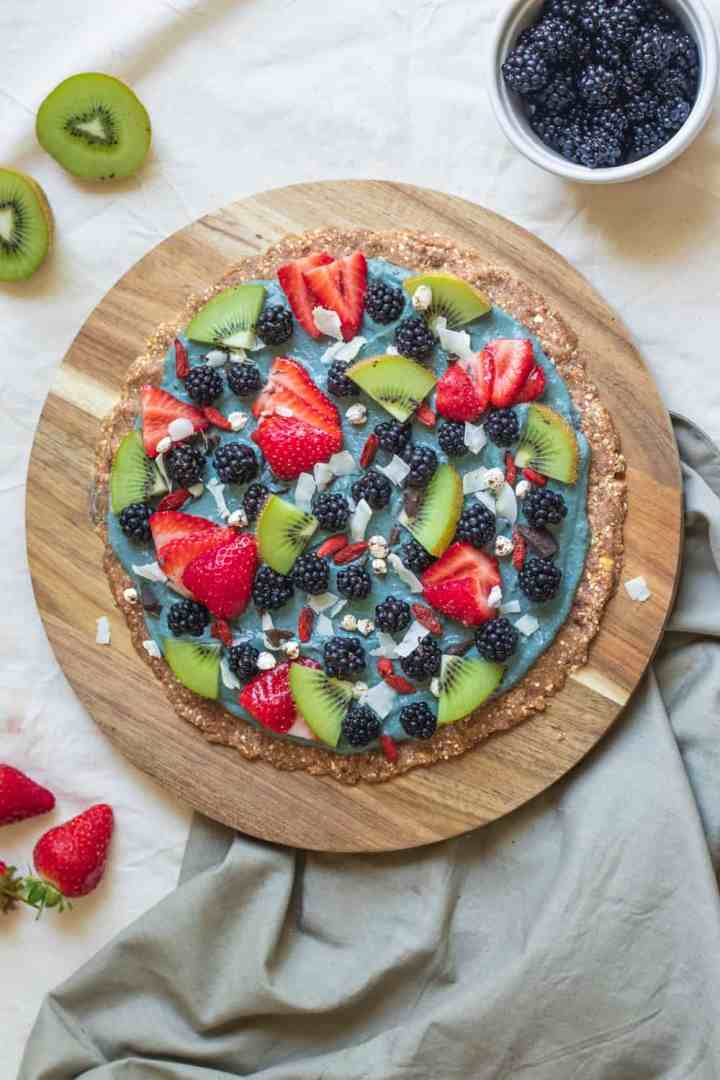 Sweet pizza with berries and blackberry sauce that is vegan and gluten-free
