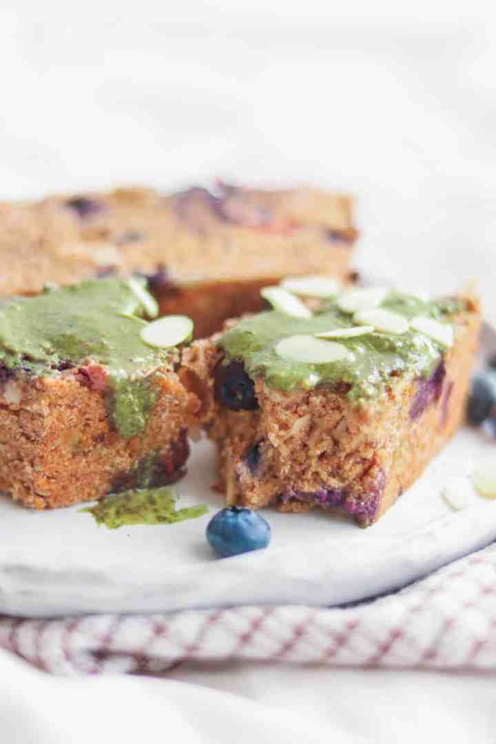 Vegan polenta cake with nut butter and blueberries
