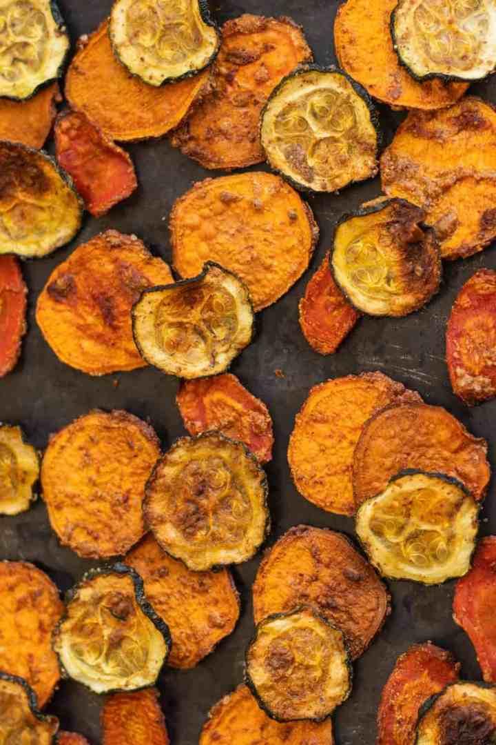 Homemade sweet potato, carrot and zucchini chips on baking sheet