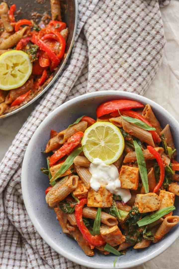 Bowl of creamy vegan tomato pasta with tofu