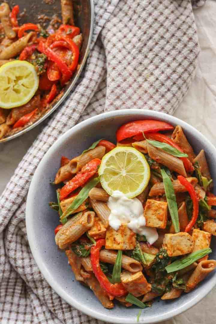 Bowl of creamy vegan tomato pasta with tofu