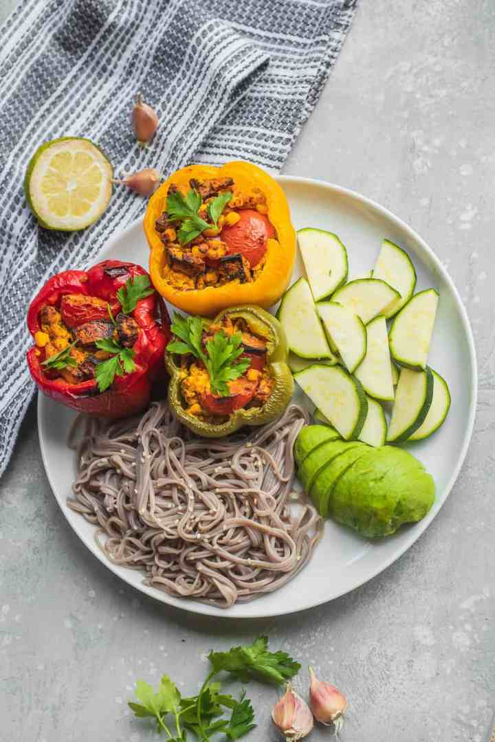 Mushroom and tofu stuffed peppers with noodles