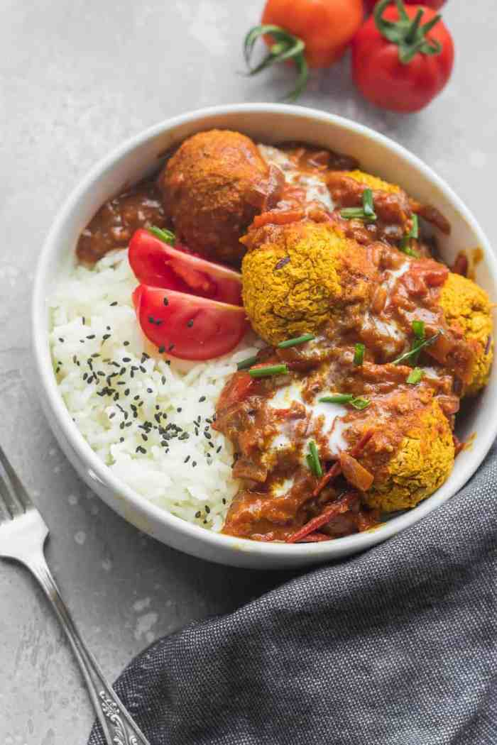 Healthy vegan meatballs with curry sauce over a bed of rice
