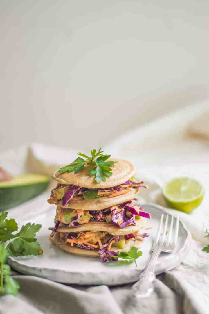 Stack of vegan buckwheat pancakes with tahini veggie slaw