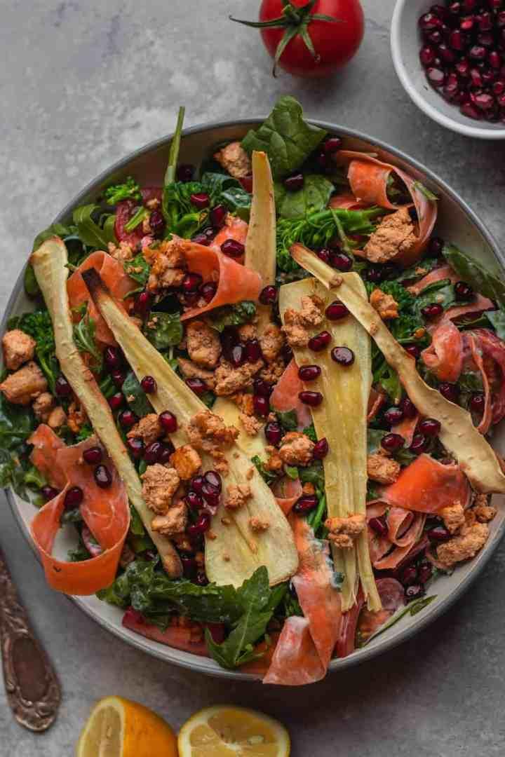 Vegan winter salad with parsnip and tofu