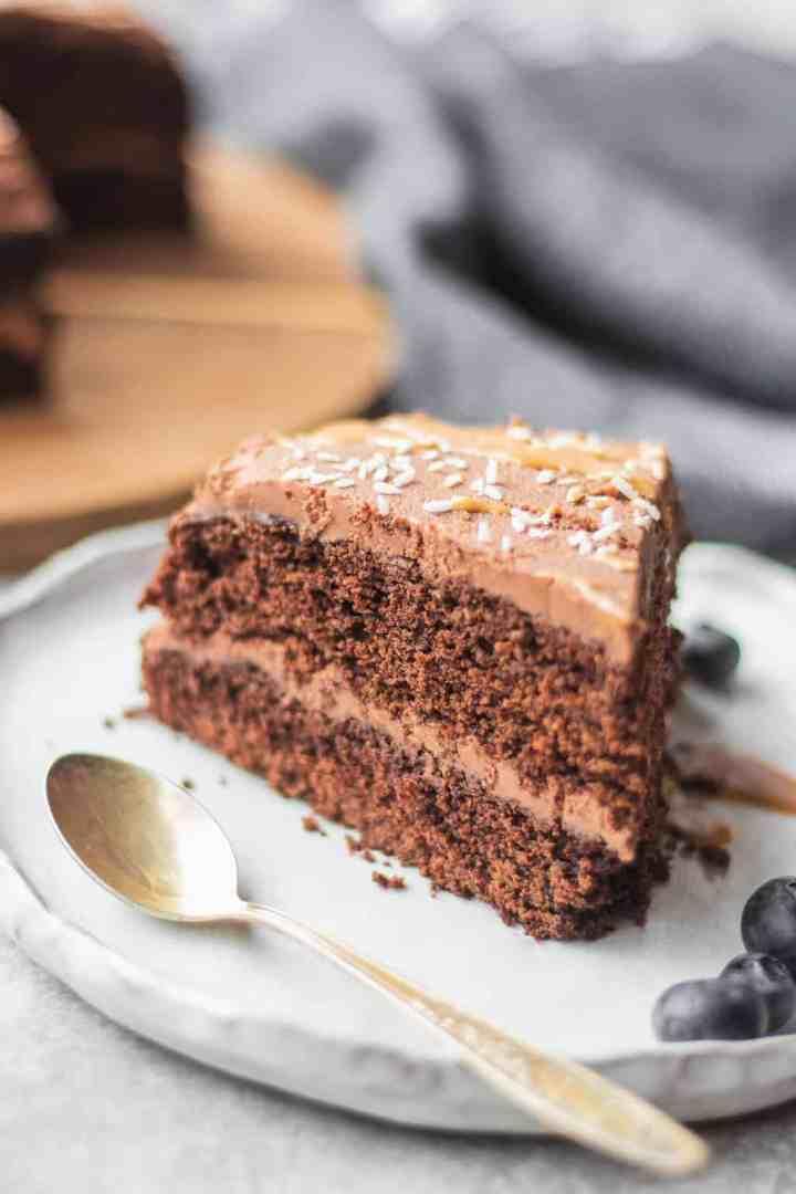 Gluten-free vegan chocolate cake on a white plate