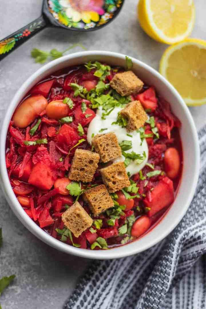 Gluten-free vegan borscht with croutons and soy yoghurt