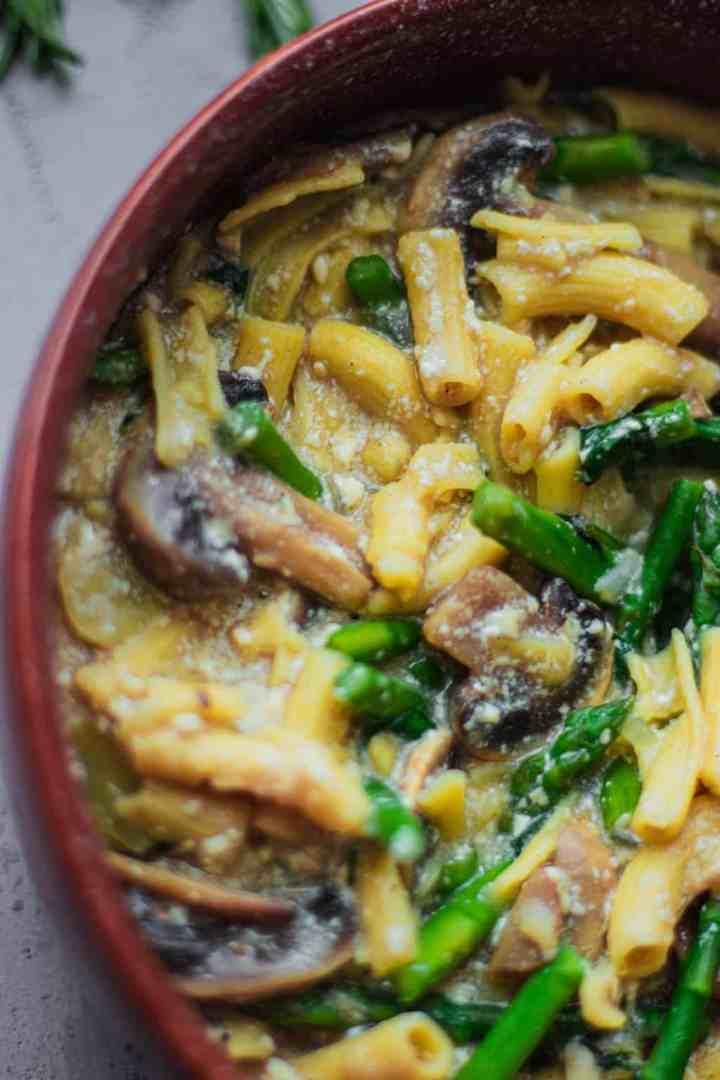 Closeup bowl of pasta with tofu and mushrooms