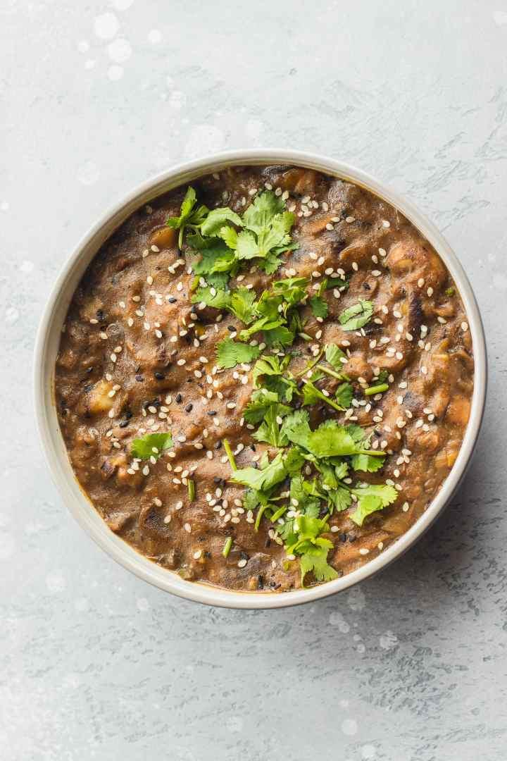 Vegan leek and potato soup in a white bowl