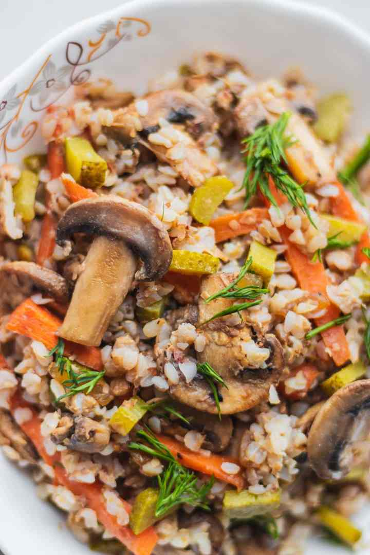 White bowl with buckwheat and vegetables