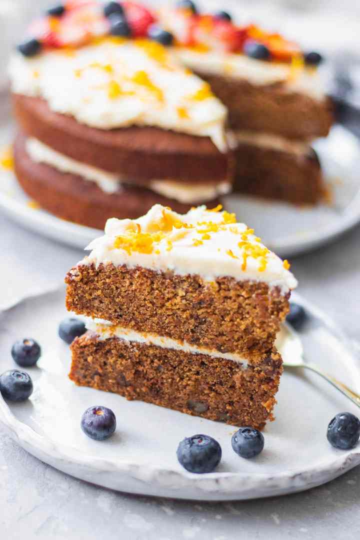 Slice of vegan cake with white frosting