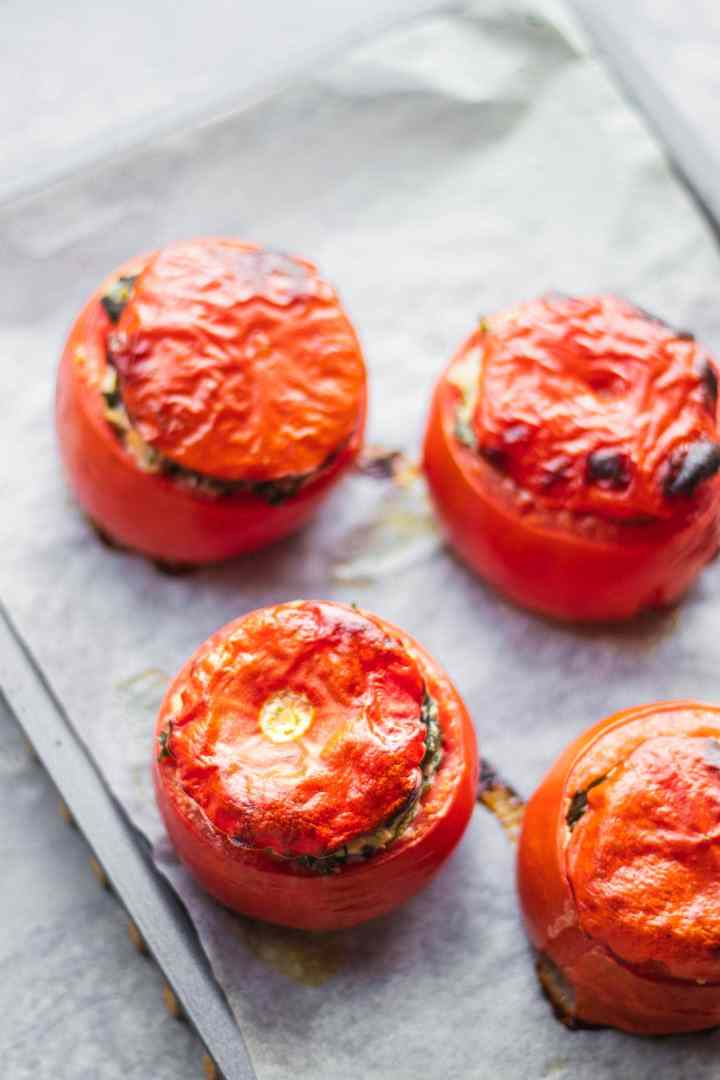 Vegan stuffed tomatoes with creamed spinach