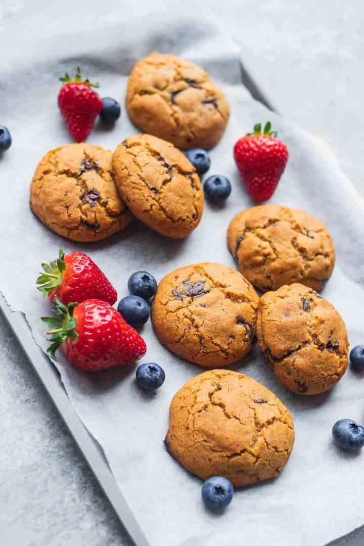 Baking tray with vegan cookies and berries