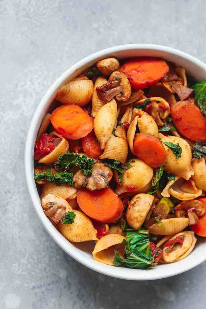 White bowl with pasta and vegetables
