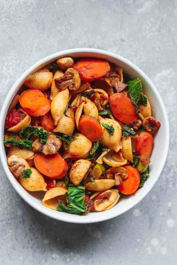 Vegetable pasta in a white bowl
