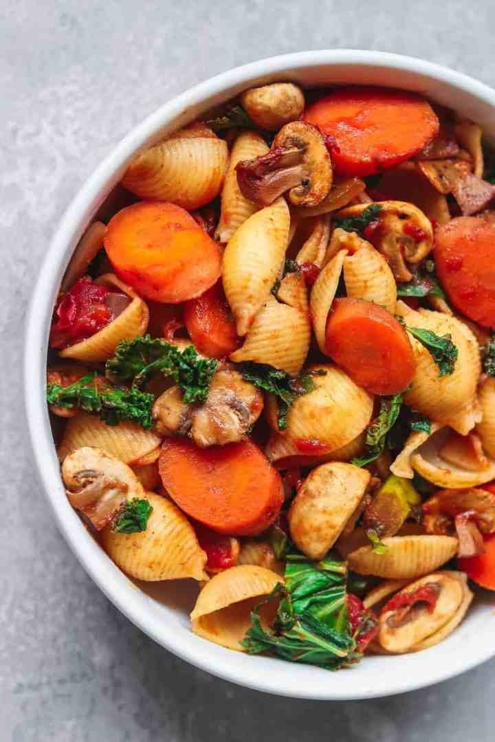 Vegetables and pasta in a white bowl