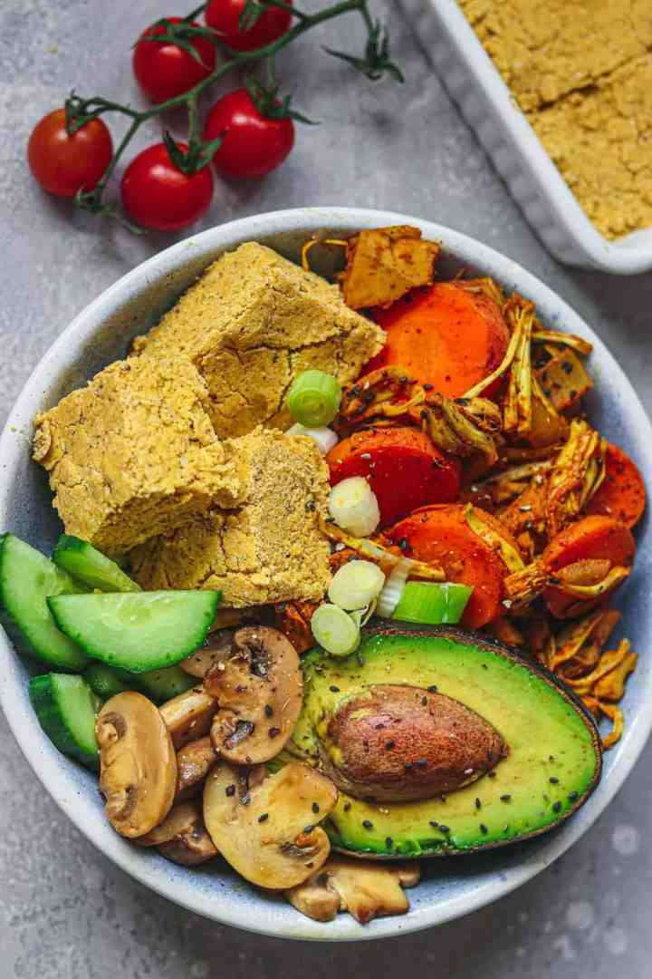 Bowl with vegan cornbread and vegetables