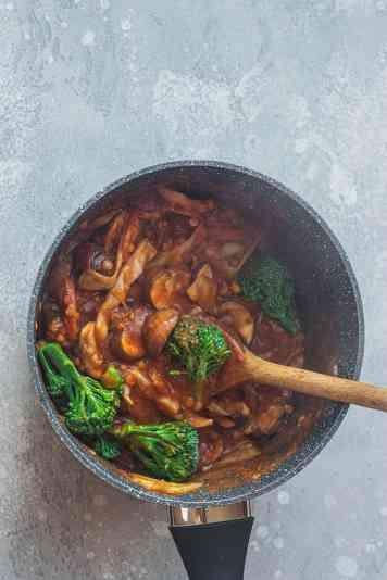 Vegan pasta sauce and broccoli in a saucepan