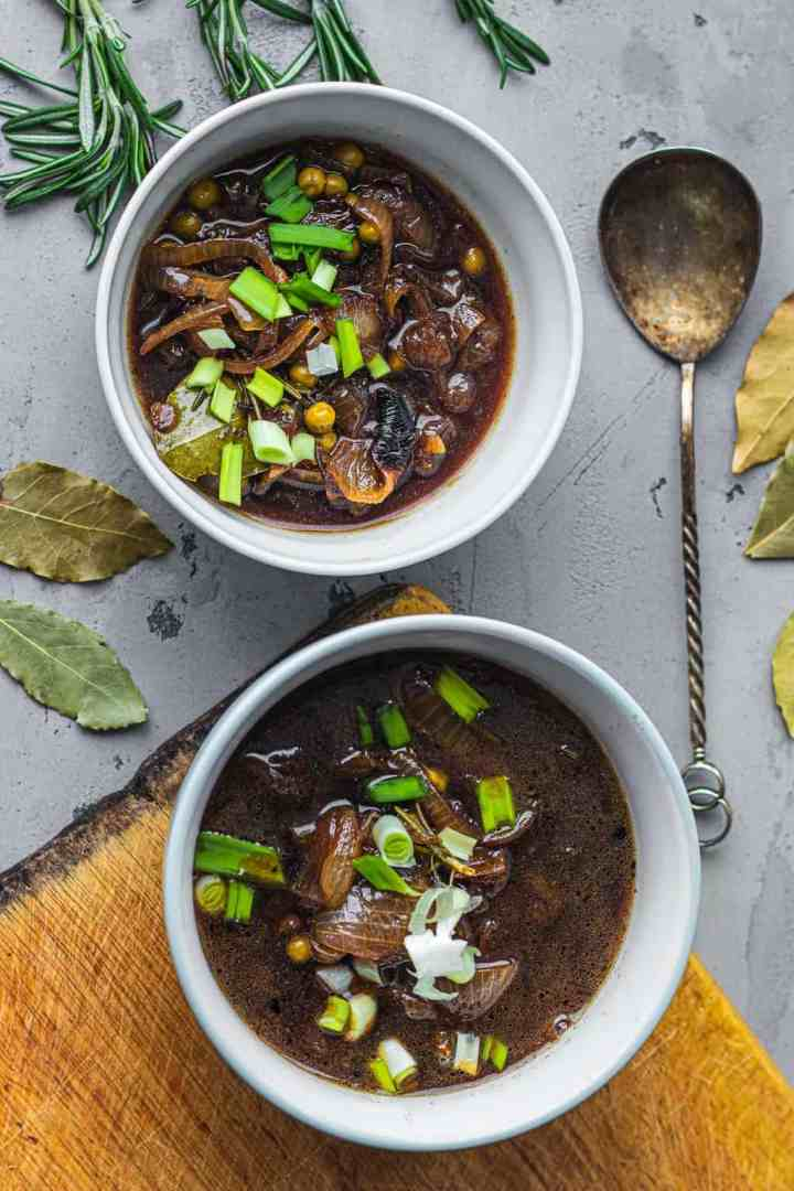 Two bowls of vegan French onion soup