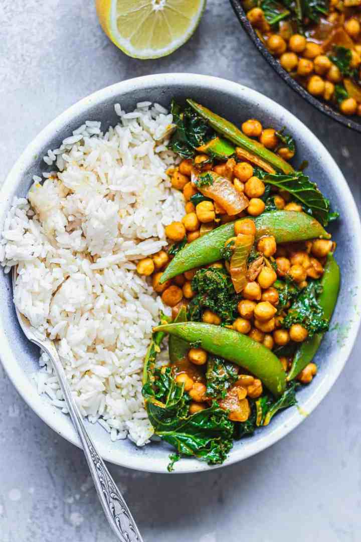 Vegan chickpea curry with snap peas in a blue bowl