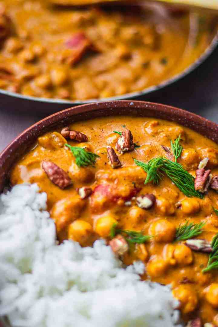 Bowl of vegan chickpeas in a curry sauce