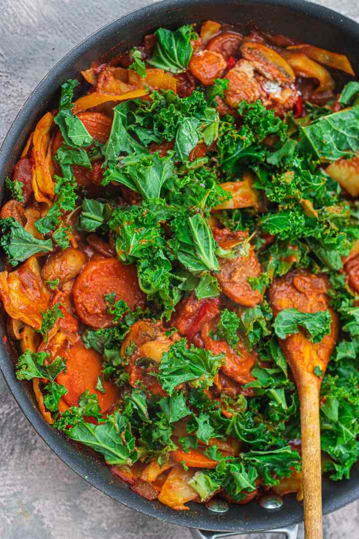 Vegetable and kale stew in a frying pan