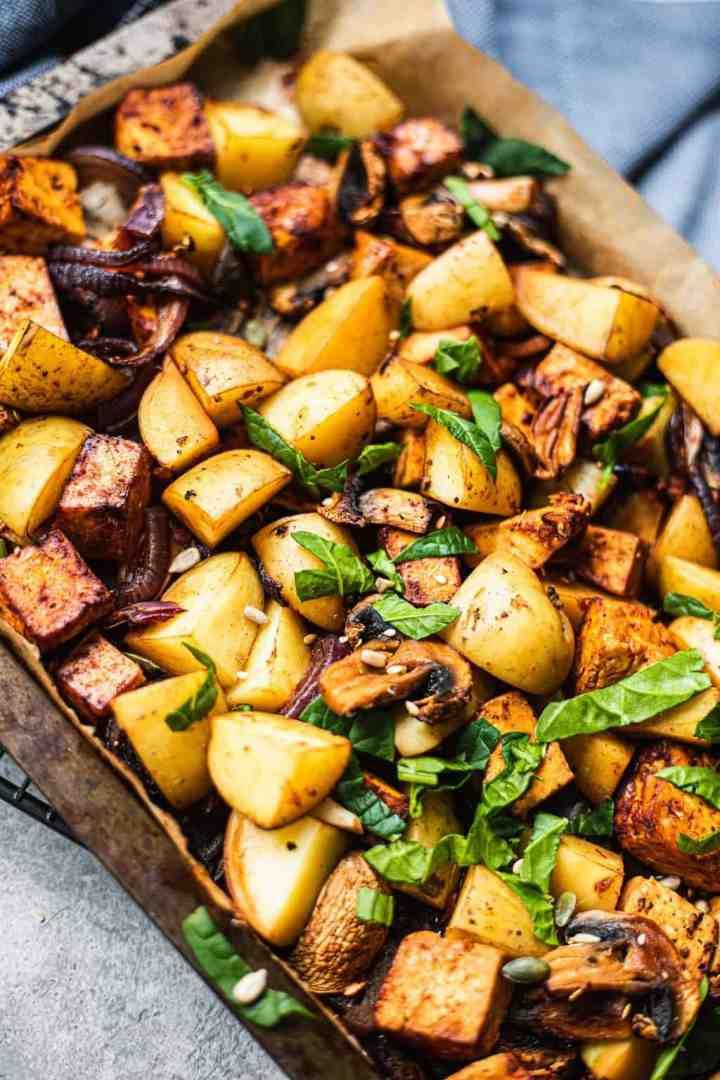 Closeup of baking tray with potatoes and tofu