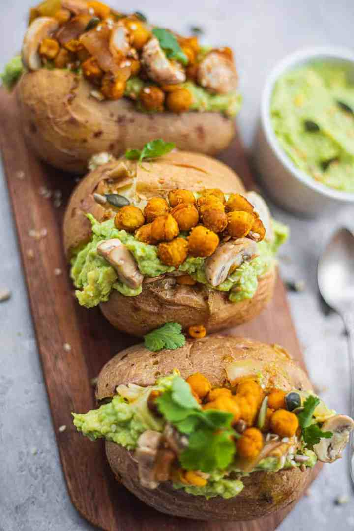 Vegan stuffed baked potatoes on a chopping board