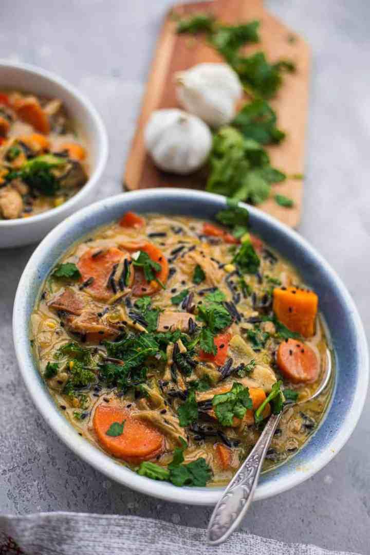 Closeup of blue bowl with vegan vegetable and jackfruit soup