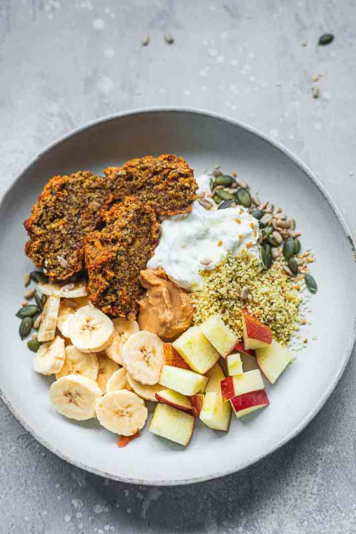 Vegan breakfast bowl with muffins, banana, apple and soy yoghurt
