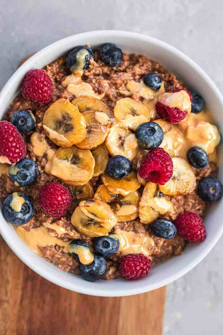 Chocolate oatmeal with banana and fruit
