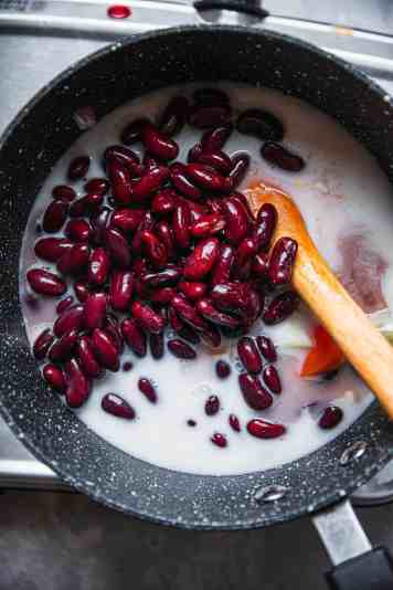Red beans and plant based milk in a saucepan
