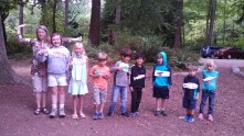 "Kids with their ""Salmon Says"" fish, ready to start the game"
