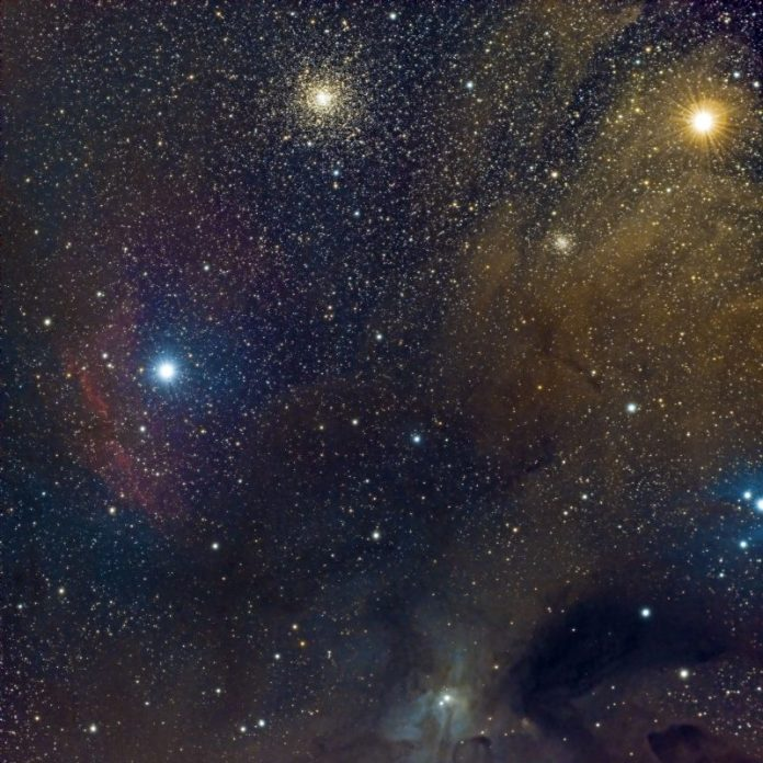 Two bright stars, one large star cluster, colorful wisps of gas.