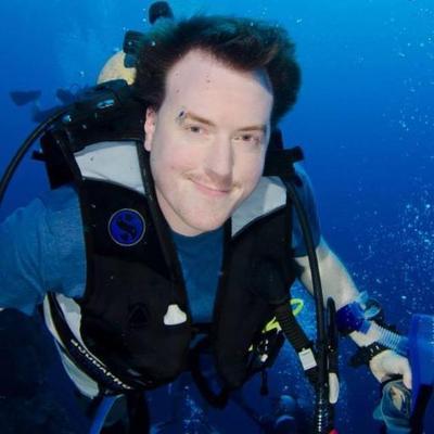 Man in scuba diving gear underwater.