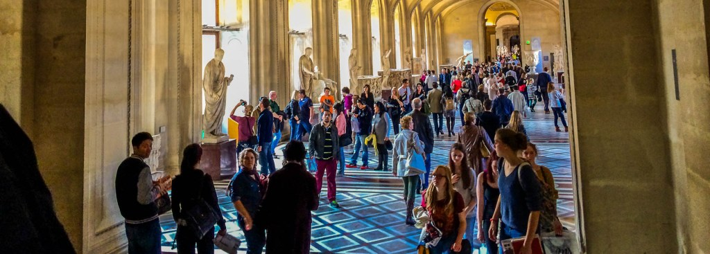 Picture of people inside Louvre museum.