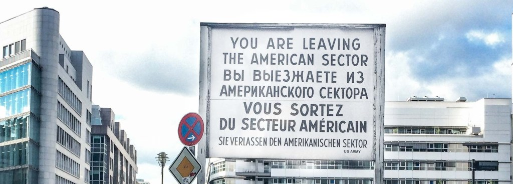 Picture of a sign in Berlin that says you are leaving the American Sector.