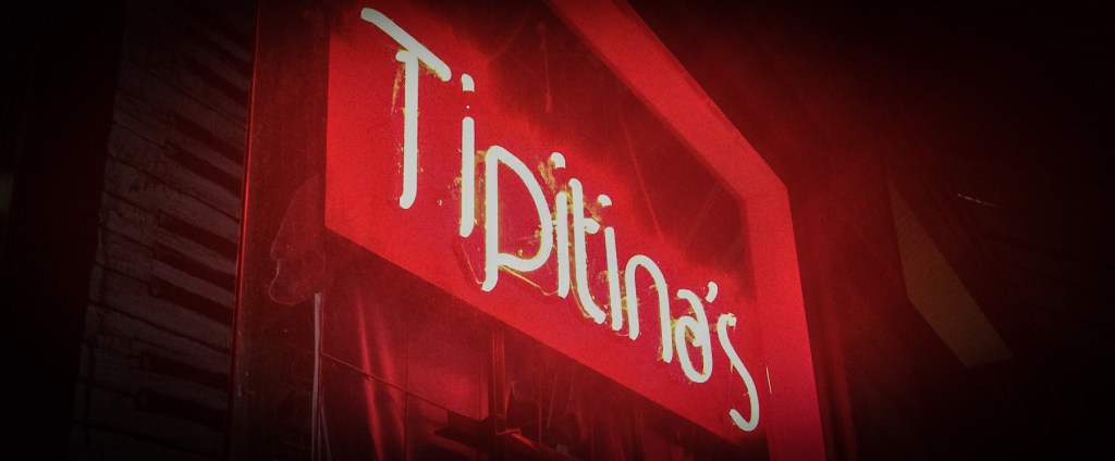 Picture of the red neon Tipitina's sign.