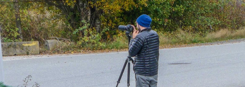 Man with camera on a tripod.