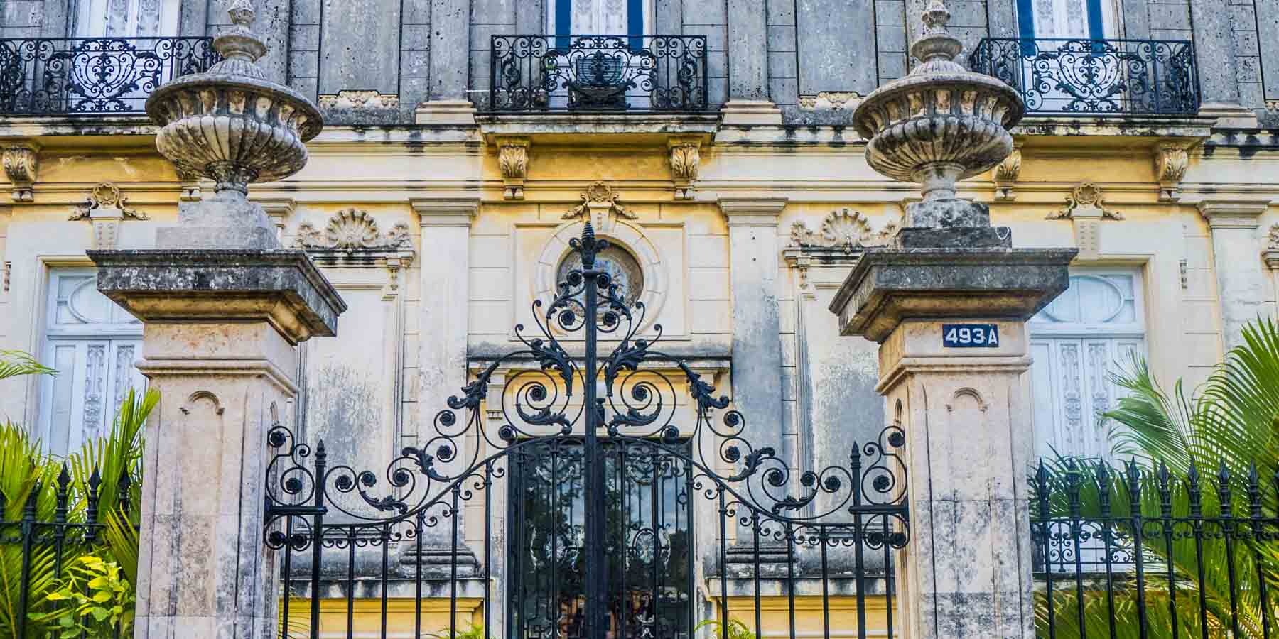 Front gates of a white mansion.