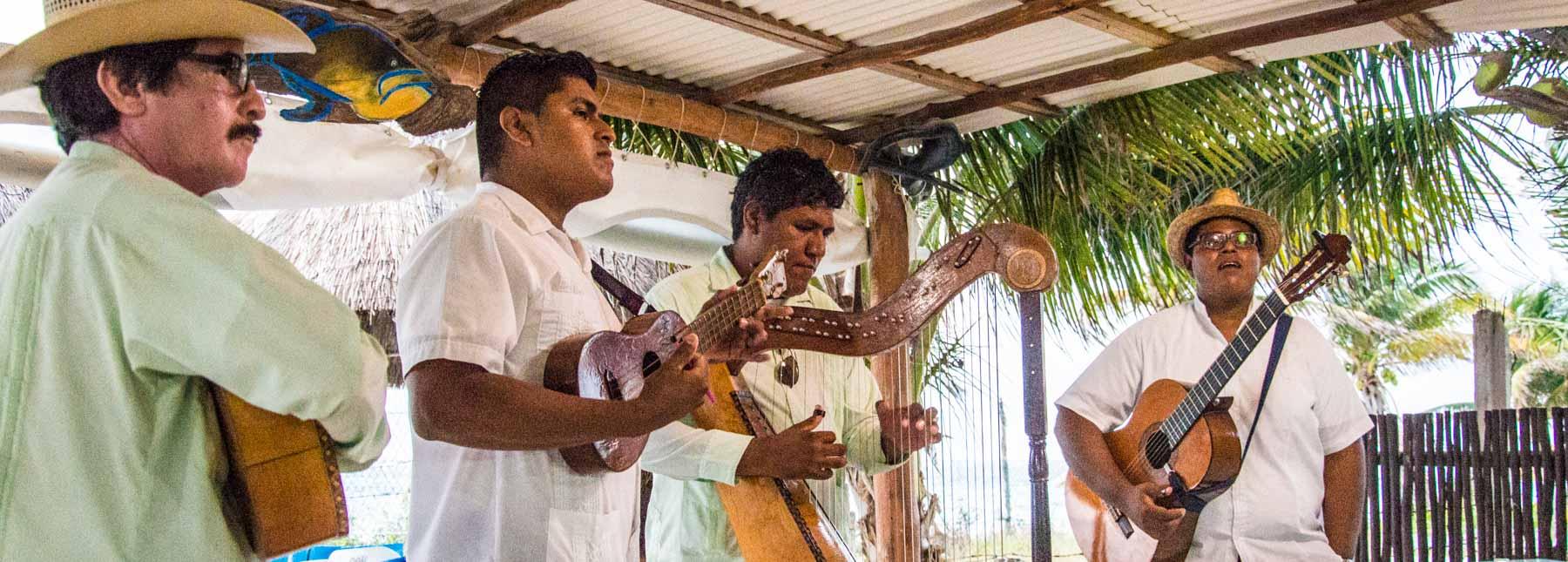 Musicians at an outdoor restaurant.