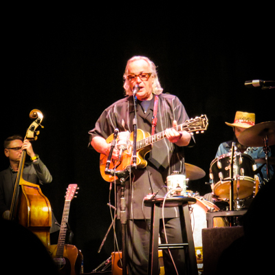 Ry Cooder on stage. Travel better with live music.