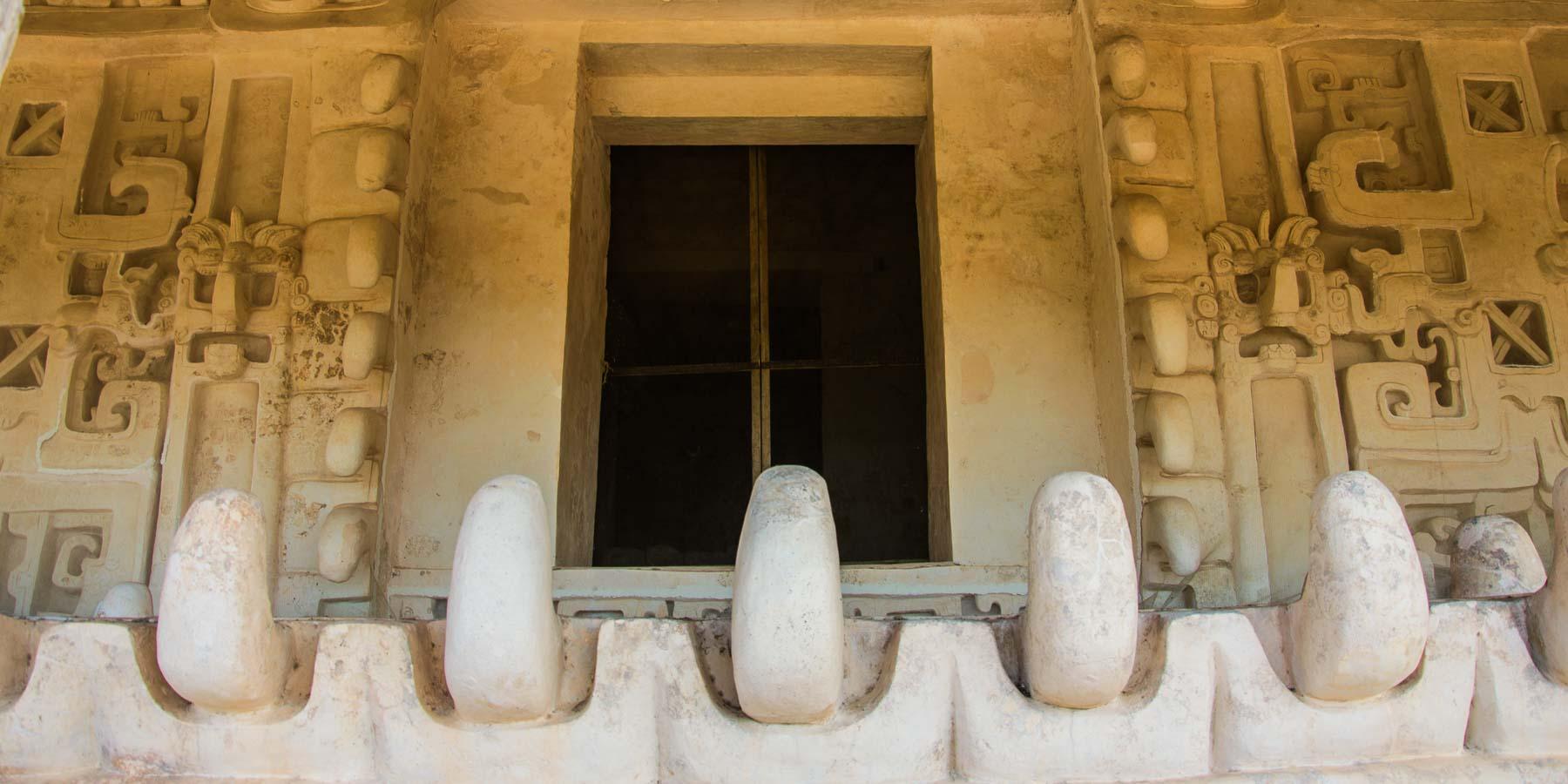 Ek Balam teeth and sculptures on temple.