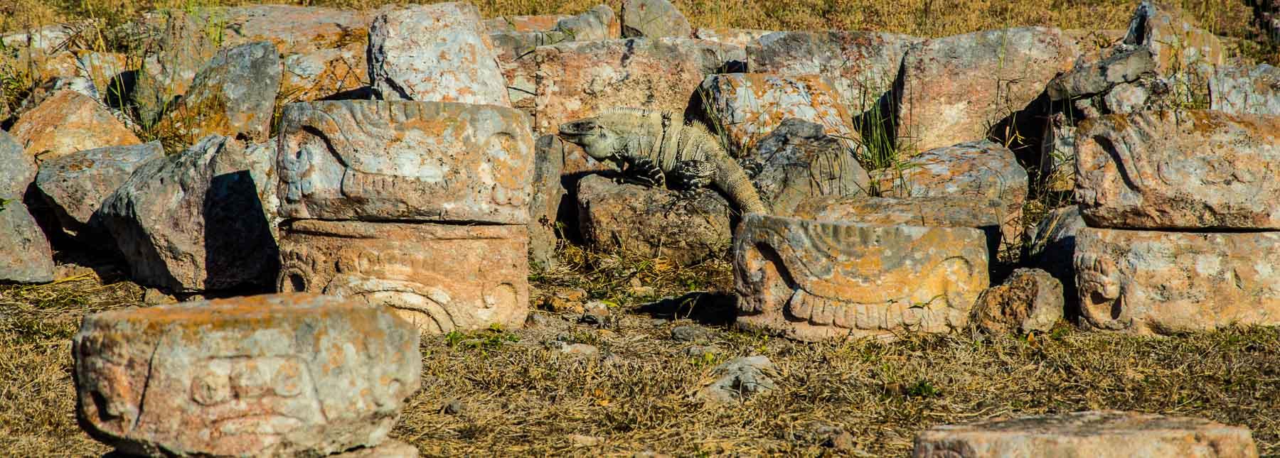 Stones with Mayan carvings at Mayan ruin of Kabah.