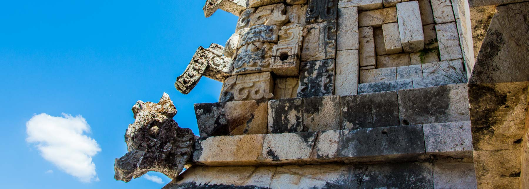Chac masks on the corner of Uxmal building.