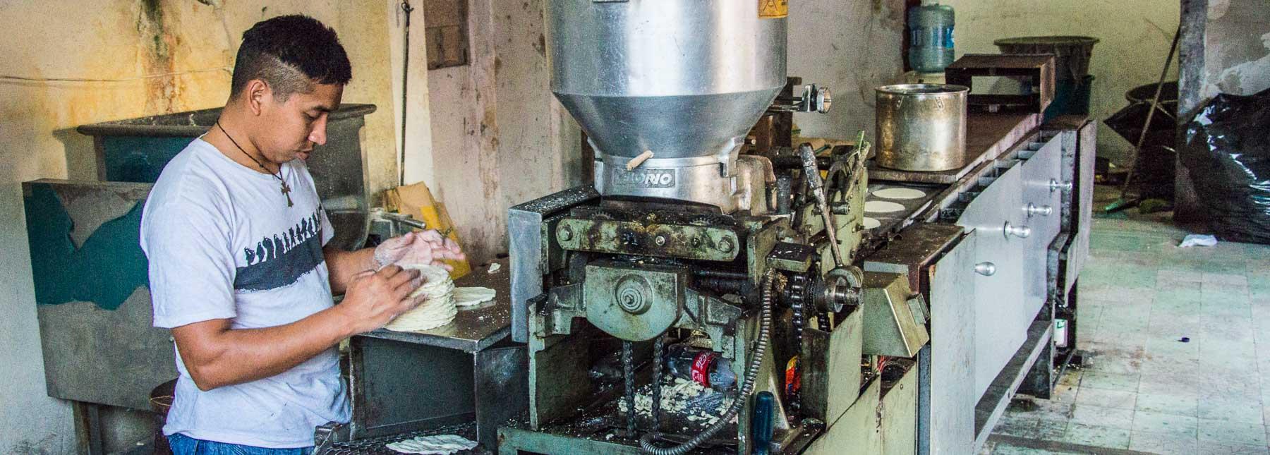 Man in Valladolid making tortillas.